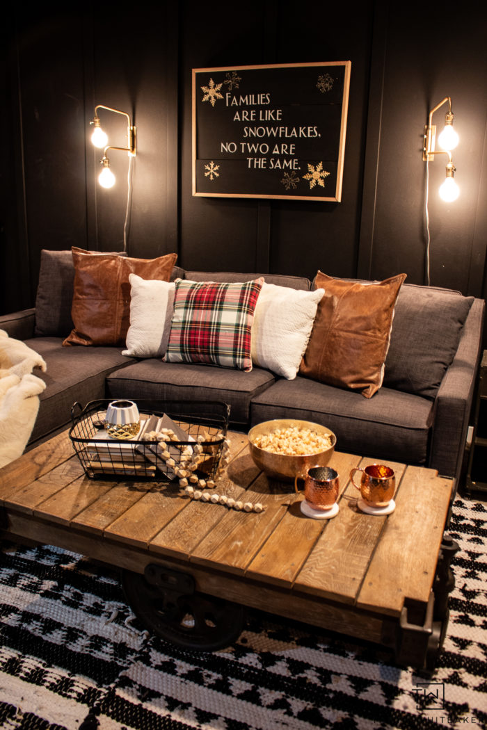 Moody movie room with winter decor and pops of plaid!