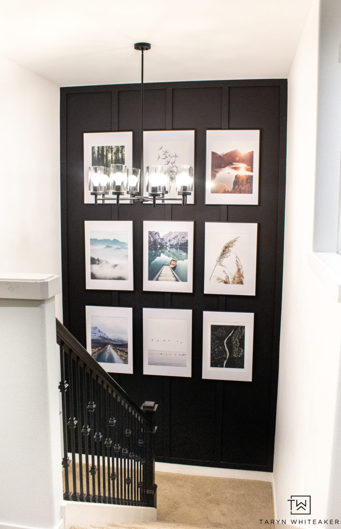 Spruce up your staircase with an oversized gallery wall and accent paint color.
