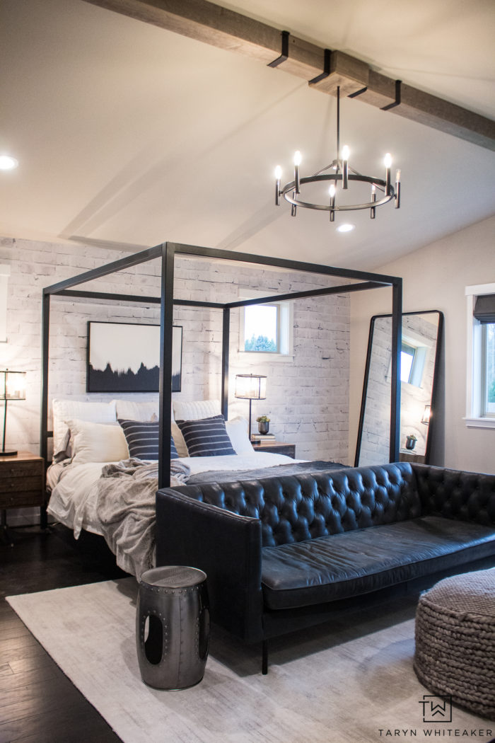 Take a tour of this rustic modern black and white master bedroom filled with wood beams, tons of texture and clean lines!