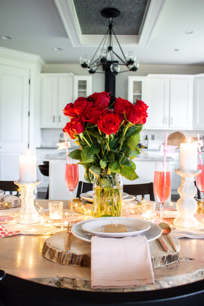 Create your own classic Valentine's Day Table Decor using simple things from around the house and one beautiful bouquet of red roses as your center piece.