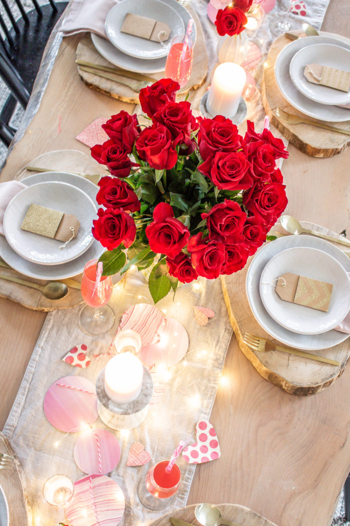 Sweet and simple Valentine's Day table decor! Red and bush with pops of twinkling lights.