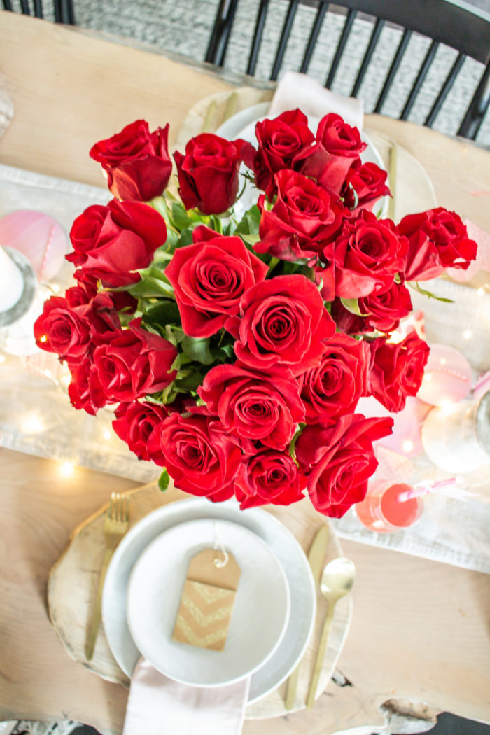 Bouquet of red roses as table centerpiece, so classic and gorgeous.