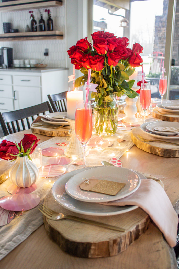 Soft and glowing Valentine's Day Table with blush pink and baby lights.