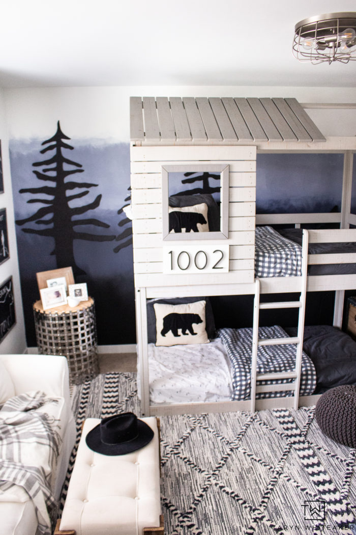 Love this modern adventure boys room complete with a DIY Forest Wall for a big impact.