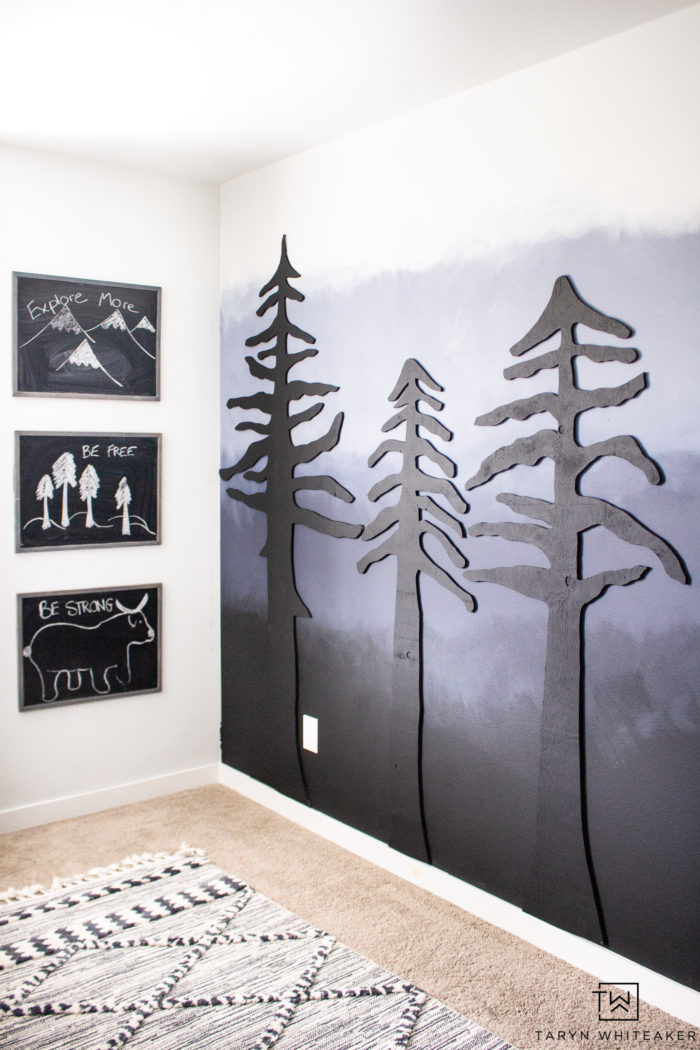 Learn how to easily create your own DIY Forest Accent Wall that will make a huge impact in your space! Cut these trees out of plywood using a jigsaw and give them a coat of paint! Full tutorial on the blog.