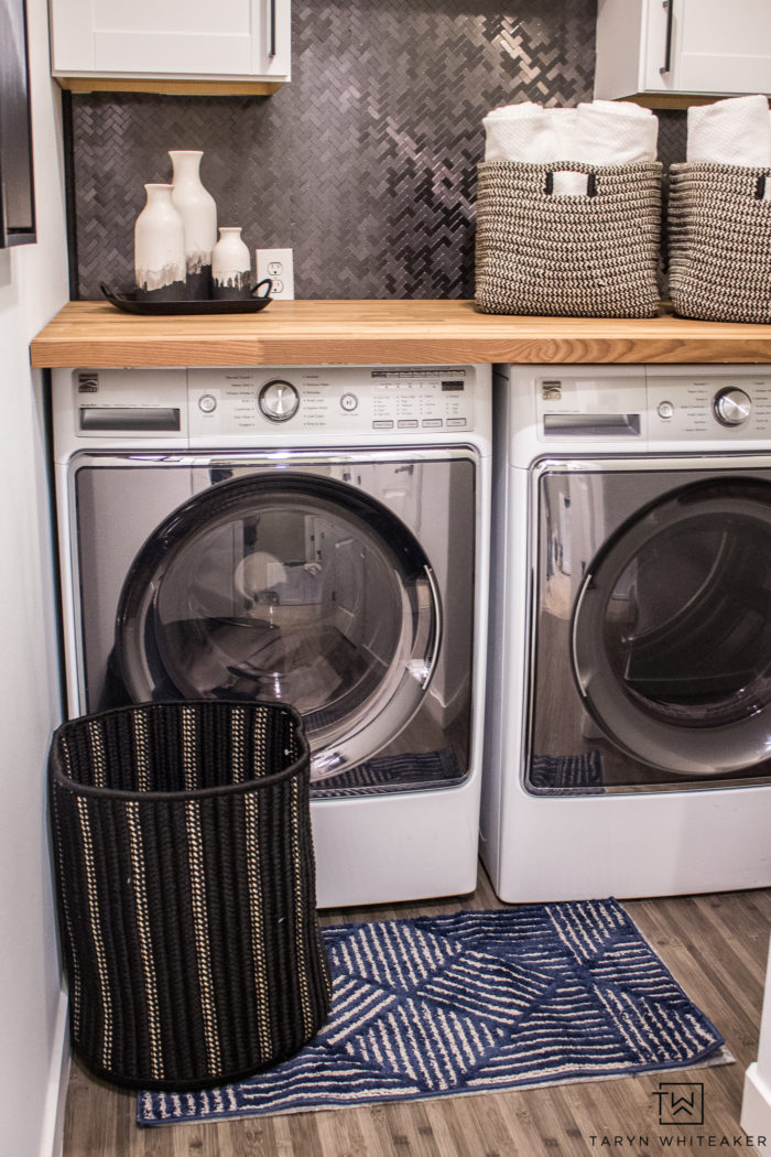 modern farmhouse style laundry room makeover. Love the black and white laundry room decor with wood countertops and fun accessories.