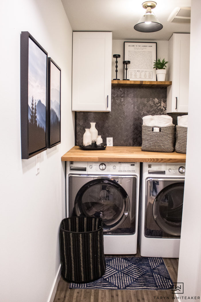 Shop this rustic modern laundry room makeover that anyone can do! DIY backsplash, butcher block countertops and pre-assembled cabinets.