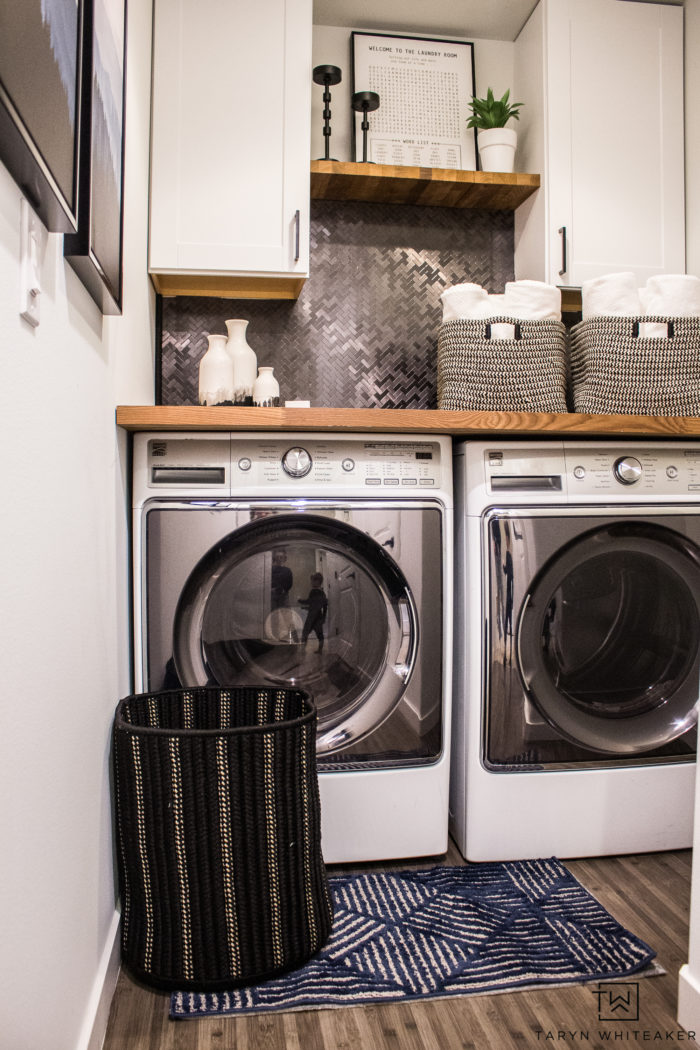 Upgrade your laundry room by adding cabinets, a countertop and more storage! So many great ideas for a small laundry room in here