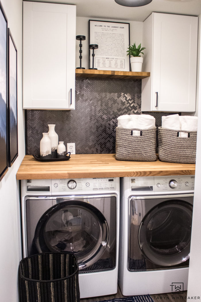 Fixer Upper Style laundry room makeover complete with butcher block countertops, white walls, DIY backsplash and more!