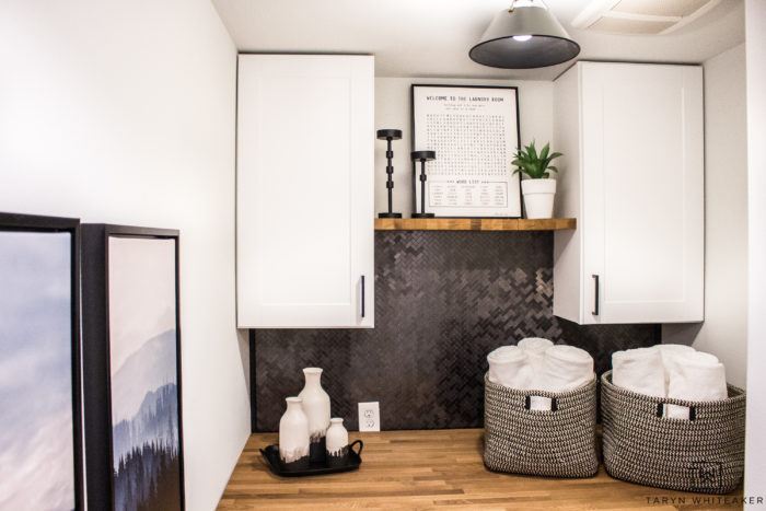Upgrade your small laundry room by adding cabinets, and decor that is both functional and decorative.