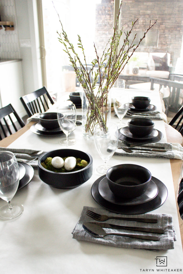 Modern easter table decor with black and white dinnerware and simple easter eggs