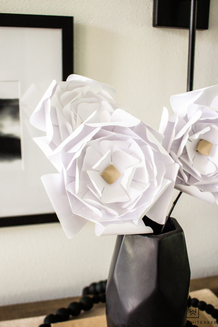 Learn how to make these easy DIY Paper Peonies using cardstock and some branches! They are a simple paper craft you can do with your Cricut Machine!