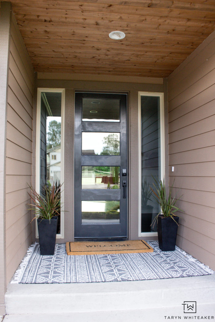 Spruce up your curb appeal with these Summer Porch Updates! Paint your door a bold dark color and plant a few fruit trees! Fresh mulch always makes your landscape pop!