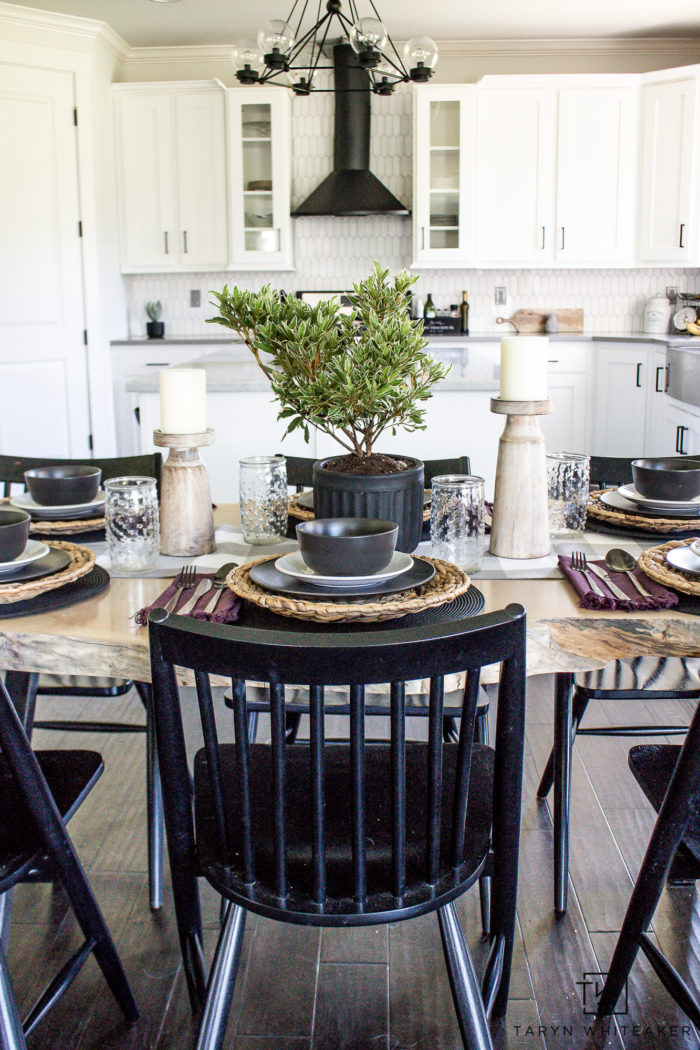 Neutral summer table decor with black and white dishes and lots of organic textures.