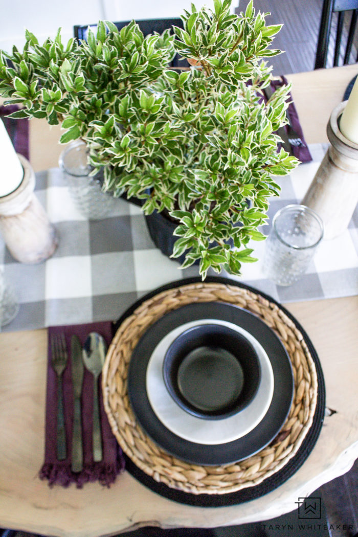 For an inexpensive centerpiece, grab a small plant off your porch for an organic and dramatic look!