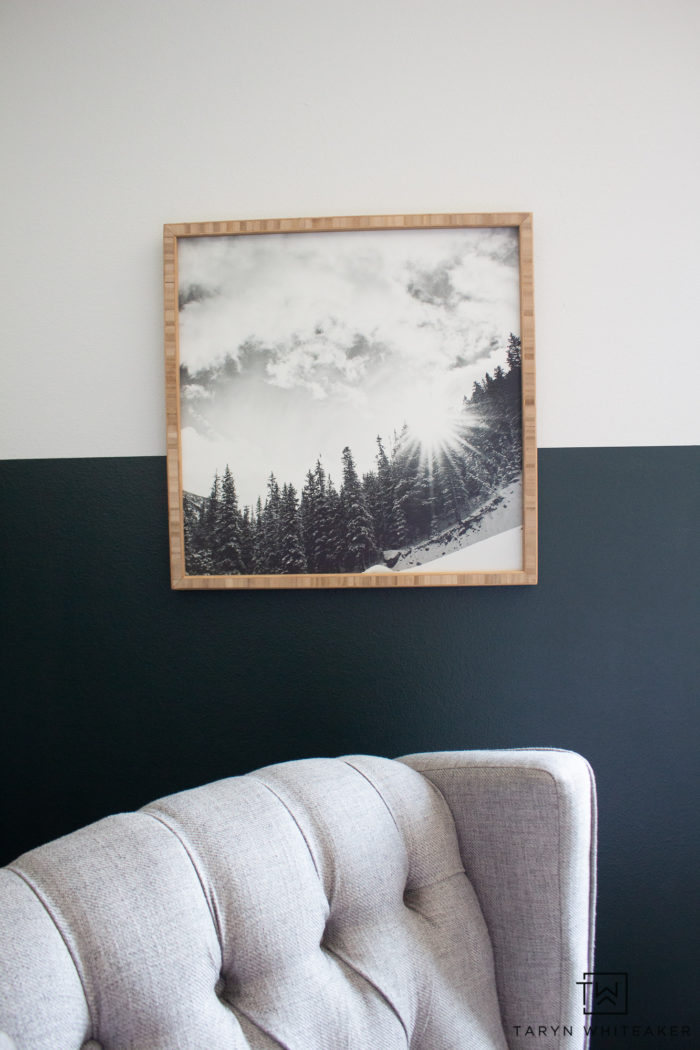 Snowy mountain print with natural wood frame.