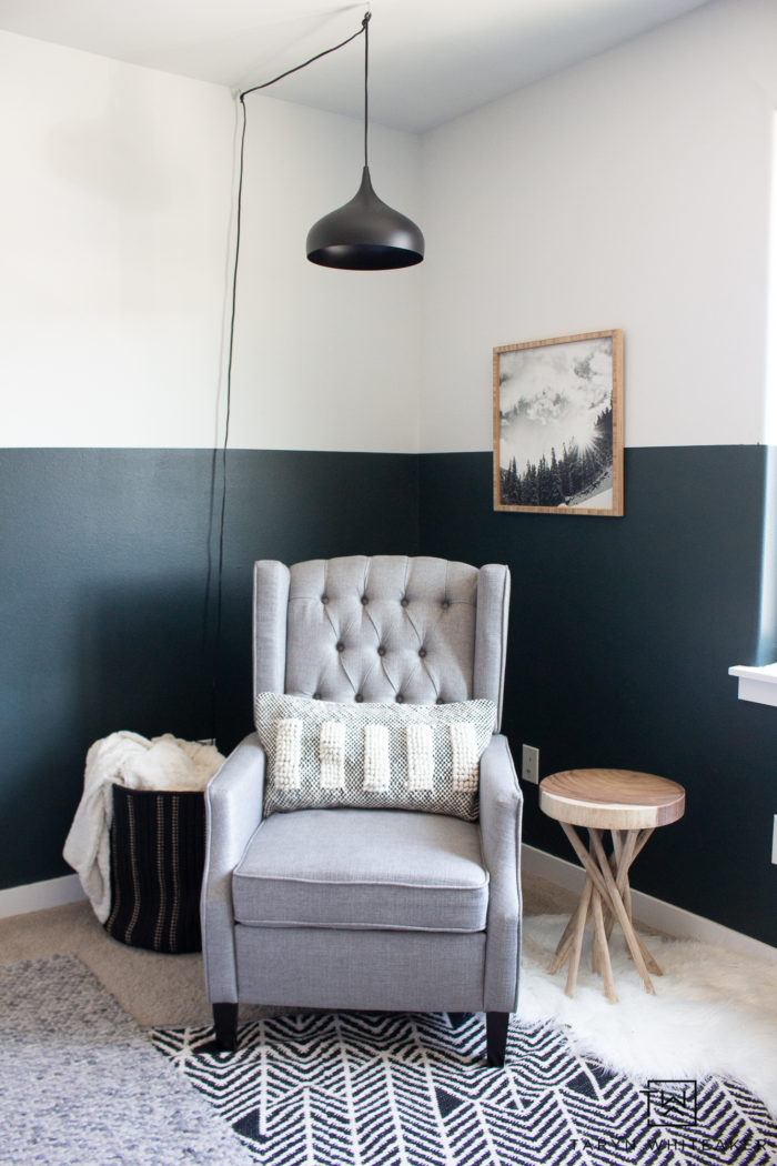Take a tour of this cozy reading corner in this gree, black and white boys room! I love the modern lodge look in here with industrial touches.