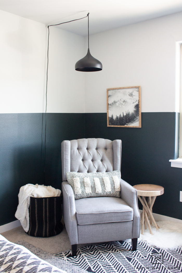 Take a tour of this cozy reading corner in this green, black and white boys room! I love the modern lodge look in here with industrial touches.