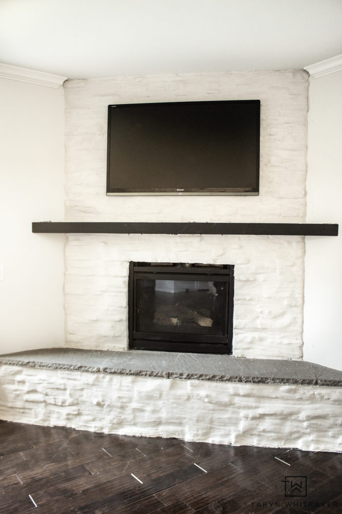 Learn how to brighten up your fireplace with this German Schmear Stone Fireplace Tutorial. Go from dark stone to bright and clean!