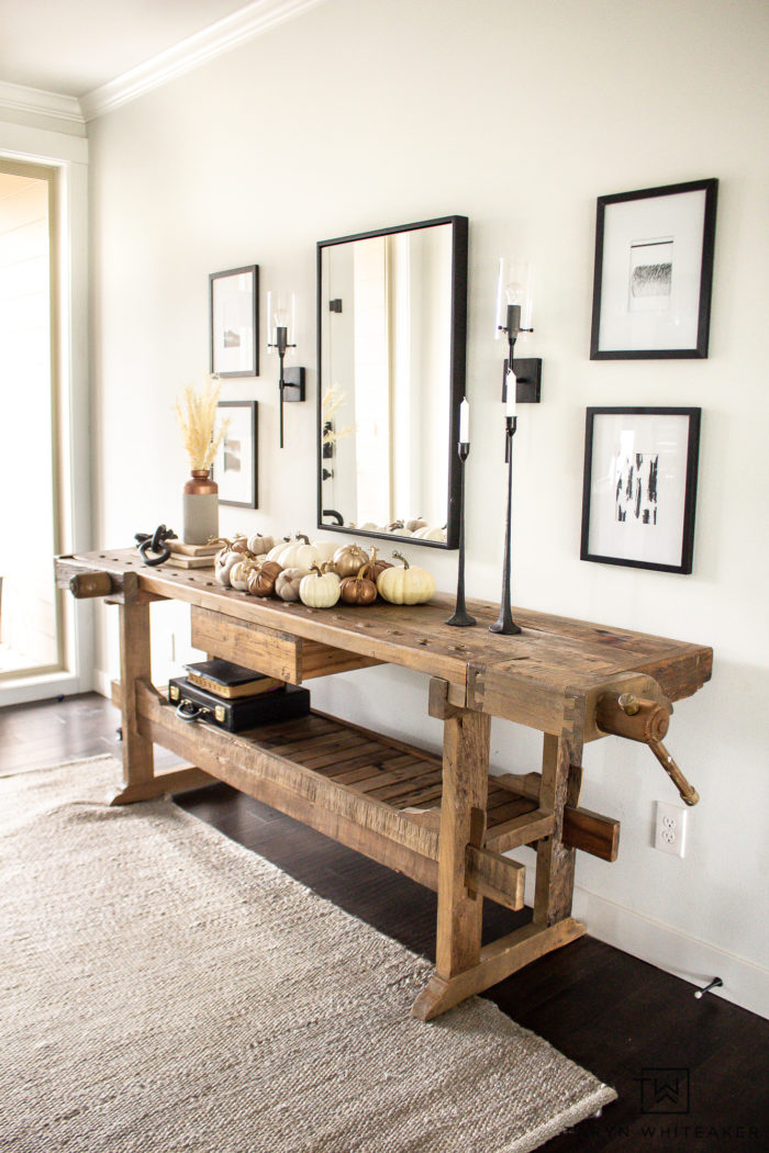 This Modern Fall Vignette shows you how to keep a clean modern look but add the warmth of fall through textures and pumpkins.