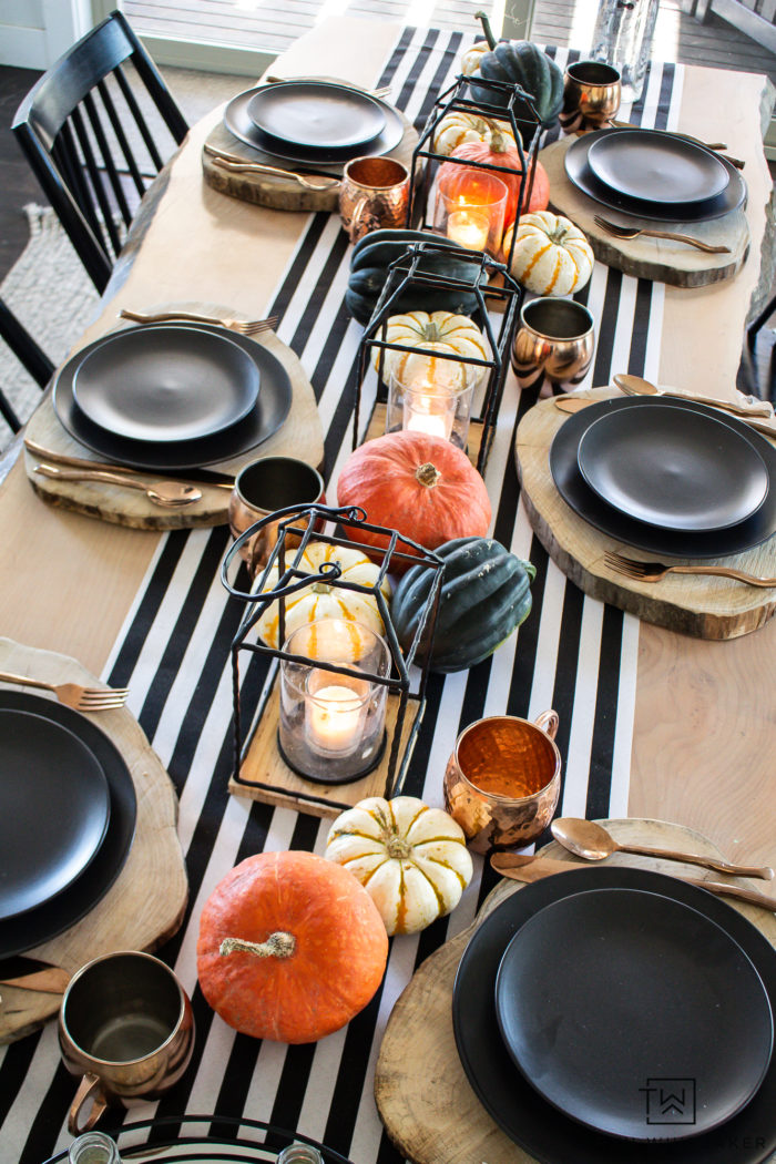 Recreate the look of this modern Halloween table decor with black and white striped table runner and heirloom pumpkin centerpiece.