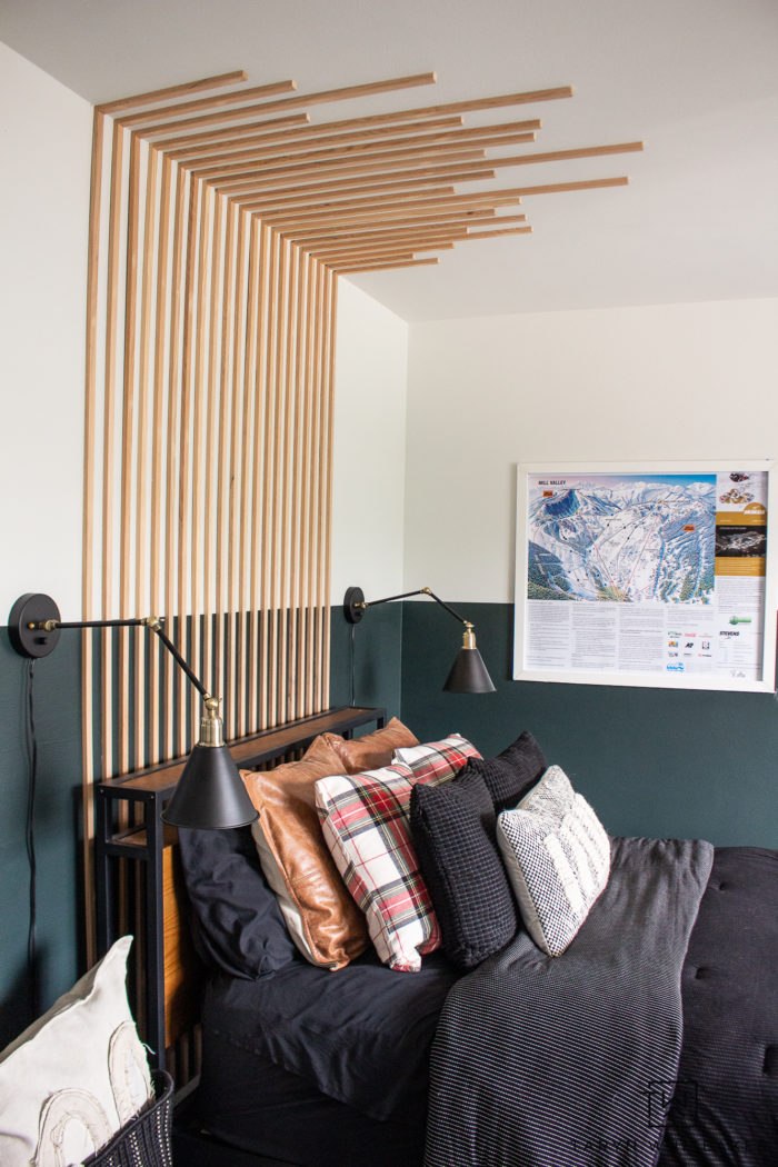 Take a tour of this Modern Lodge Bedroom with color blocked walls, wood accent wall and cozy kid's reading corner.