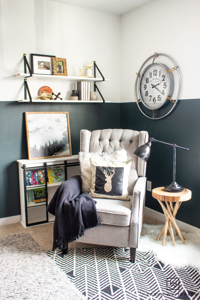 Cozy kids reading corner with a recliner, cozy rustic accents and white leather strap shelves.