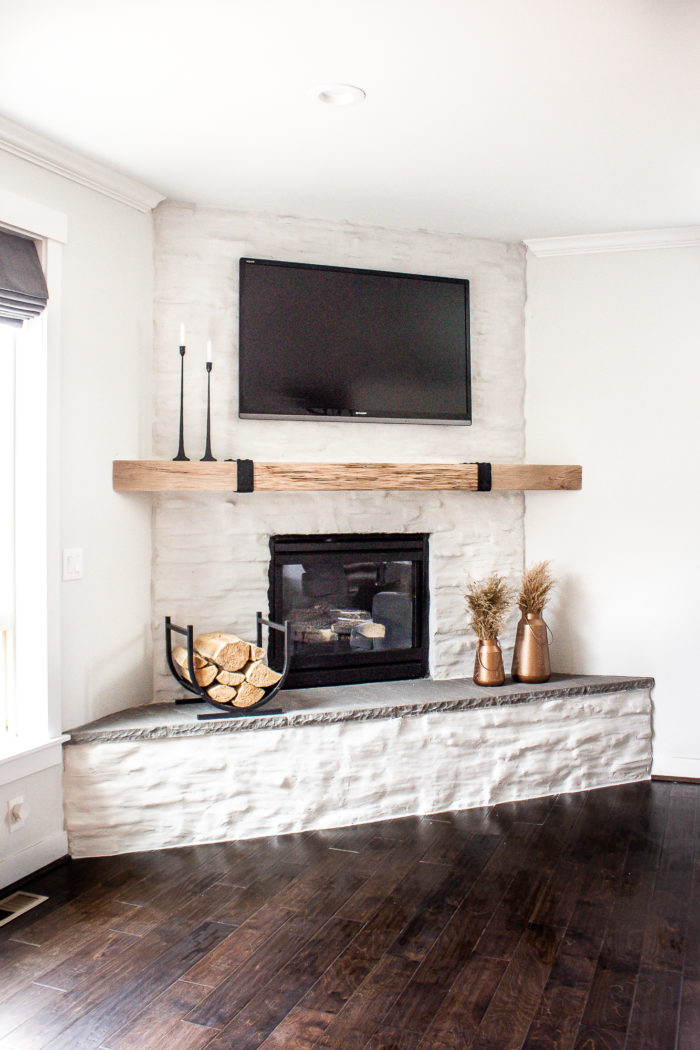 Get this DIY Mantel Tutorial and learn how to make your own reclaimed wood mantel using open shelving. Awesome modern farmhouse fireplace or rustic modern!