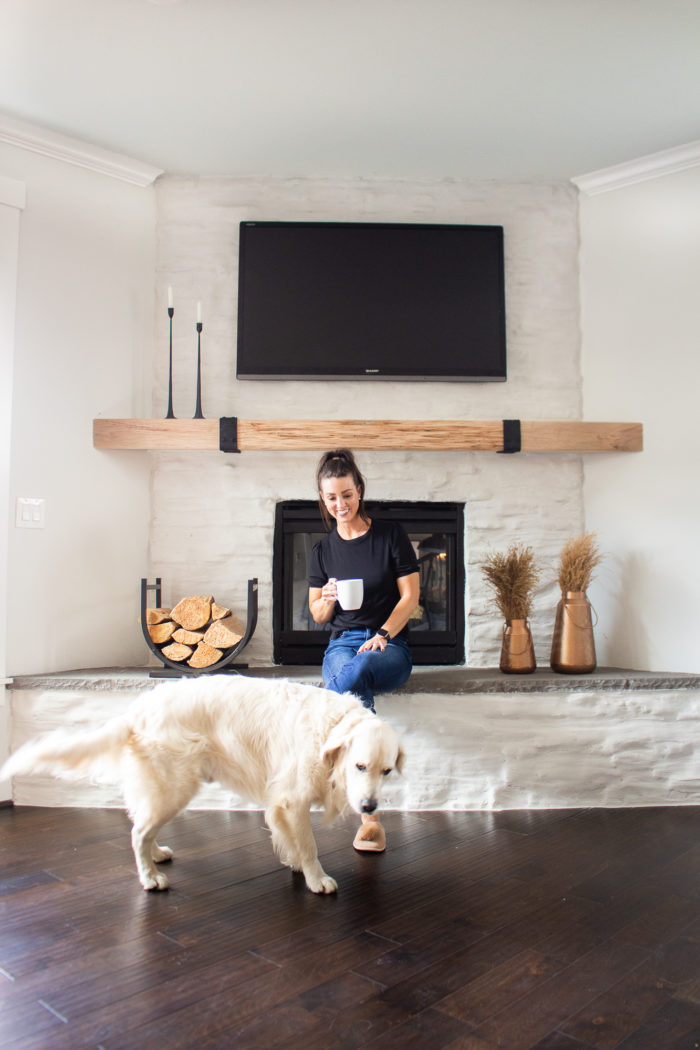 Take your dark stone fireplace and turn it into something more modern and chic with this stone fireplace makeover on a budget!