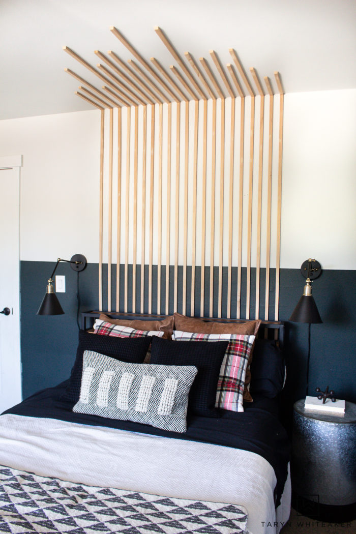 Add dimension to your bedroom with this Vertical Slat Wall that also works as a DIY headboard! Easy bedroom DIY.