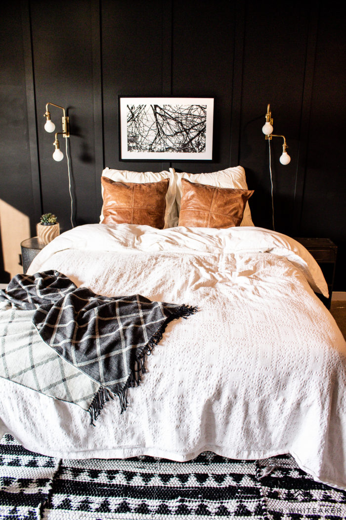 Dark moody bedroom with black walls and gold accents!
