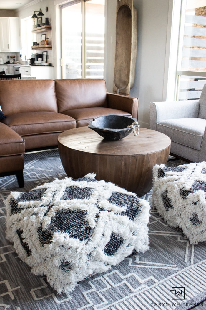 Check out this neutral living room filled with a Organic Modern Furniture and tons of texture! Love the cognac sectional and natural look.