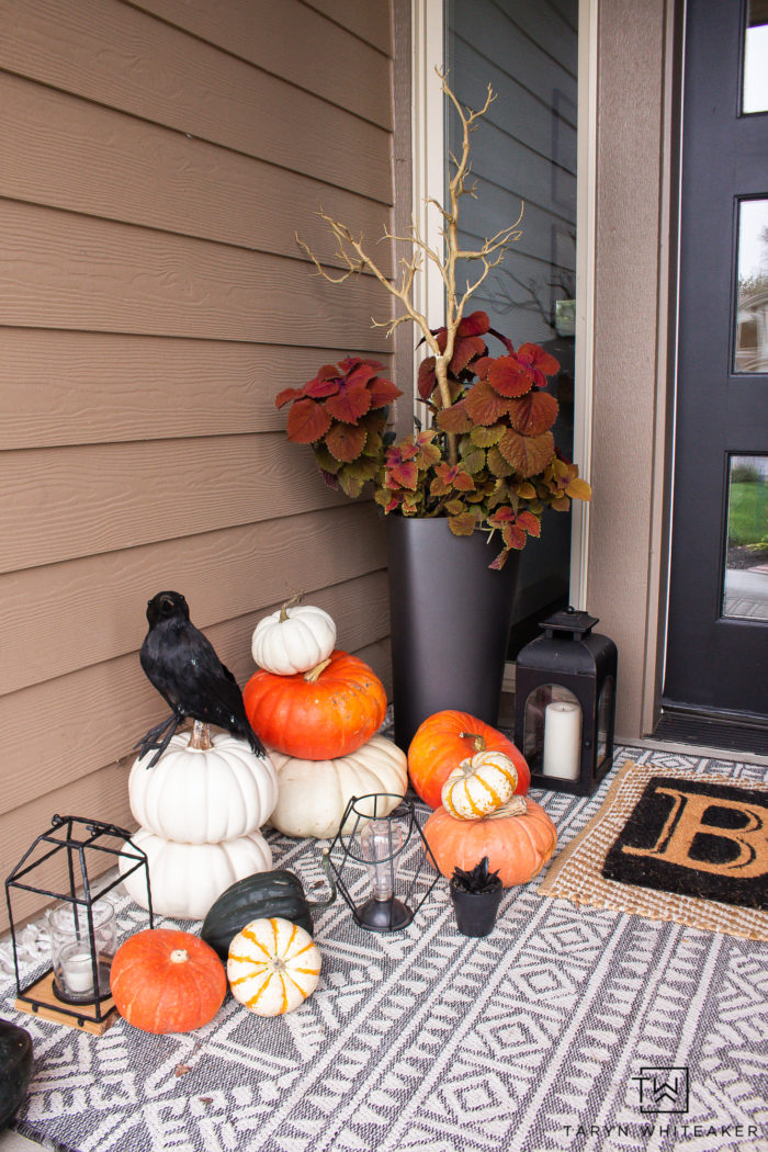 Transition your fall porch with some Halloween Porch Decor by adding black crows, lanterns, braches and boo door mat!