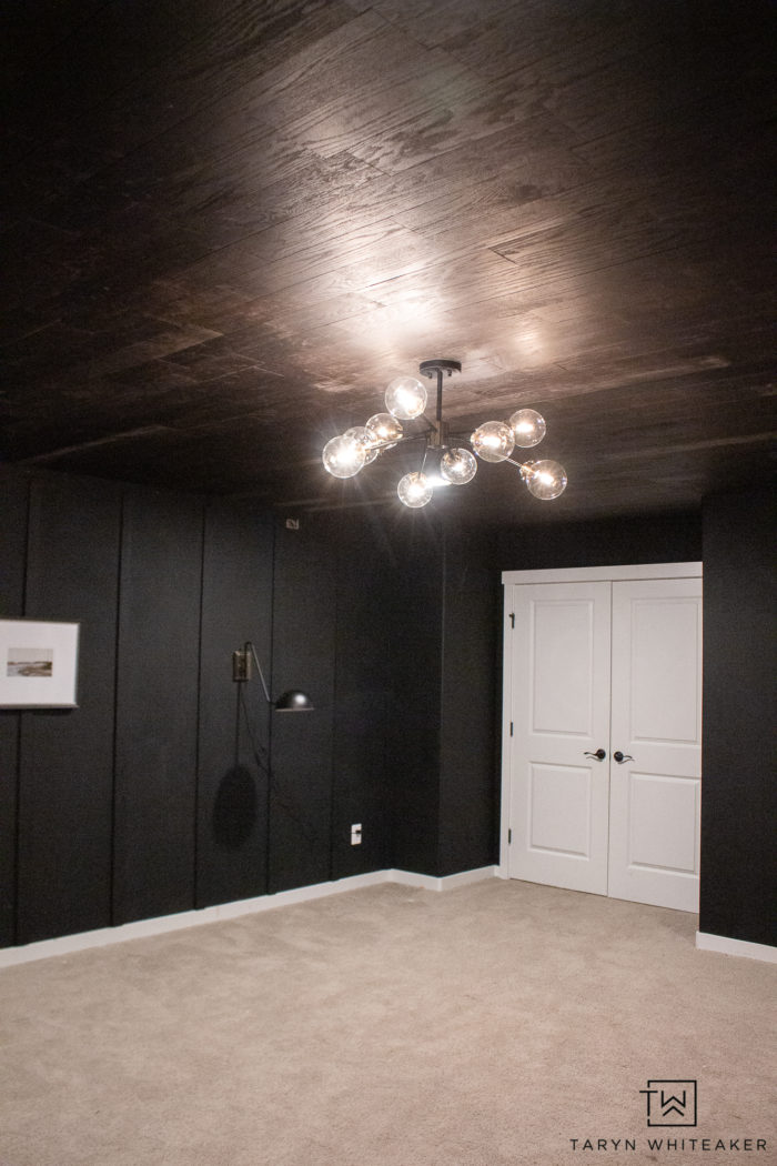 This bonus room is slowly turning into the bold mid century modern space starting with a DIY plank ceiling for a moody look.