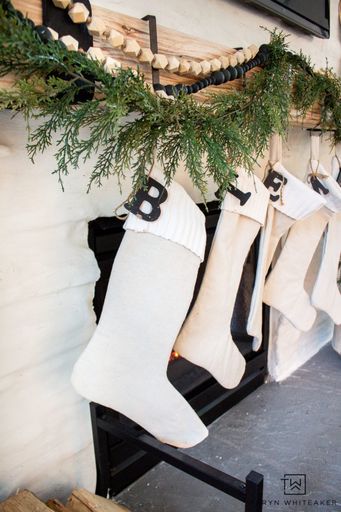 An Asymmetrical Garland Mantel is the perfect way to decorate your mantel for Christmas. It's simple, modern and festive