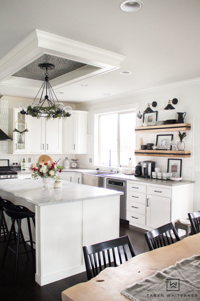 Take a tour of this design blogger home using tons of Neutral Christmas Decor that still feels festive! From black and white Christmas decor and lots of greenery.