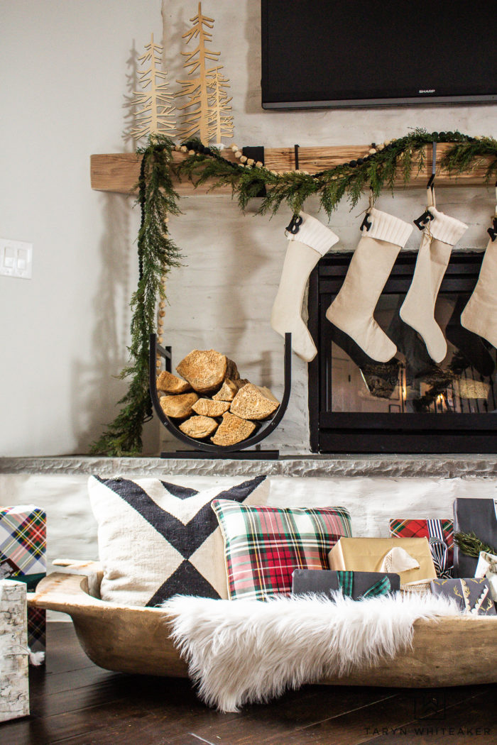 Fill a large vintage dough bowl with presents and pillows to add a new touch to your Christmas decor.