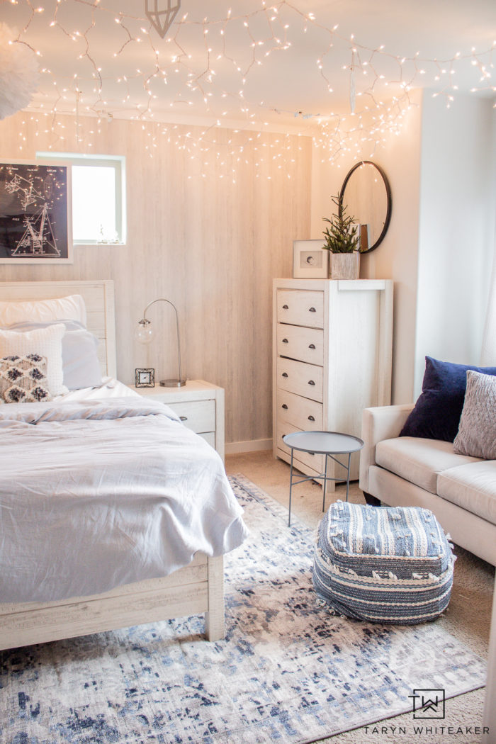 Check out this Winter Wonderland Bedroom with bright white and baby blue with tons of hanging icicle lights! Perfect for a winter bedroom.