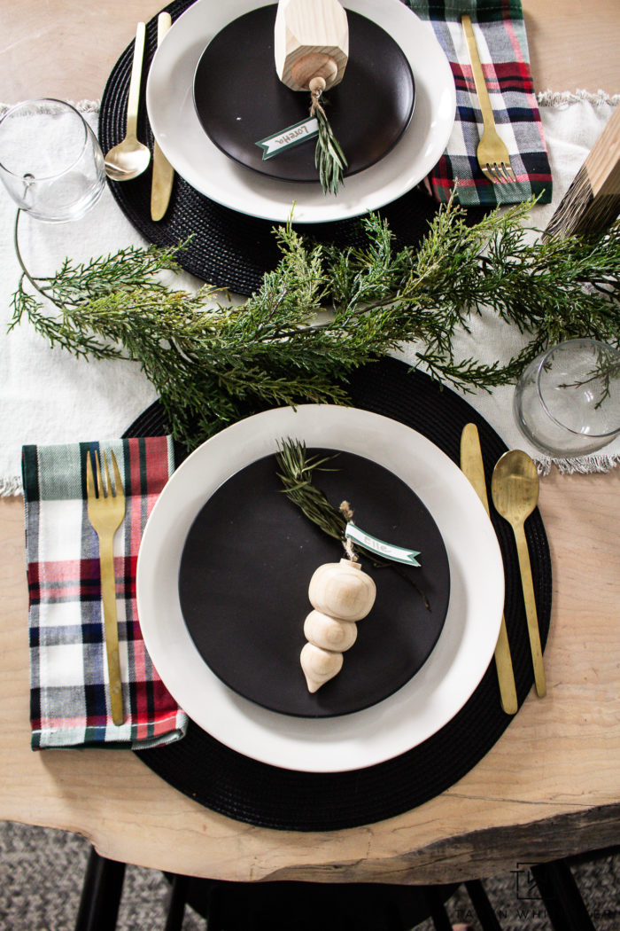 Modern black and white Christmas table with pops of tartan.