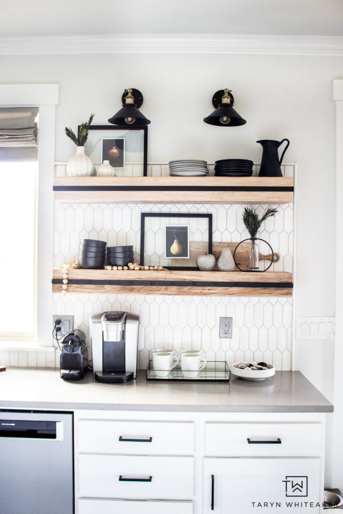 Giving you ideas for some Winter Kitchen Shelf Styling with adding bits of greenery and moody fruit prints.