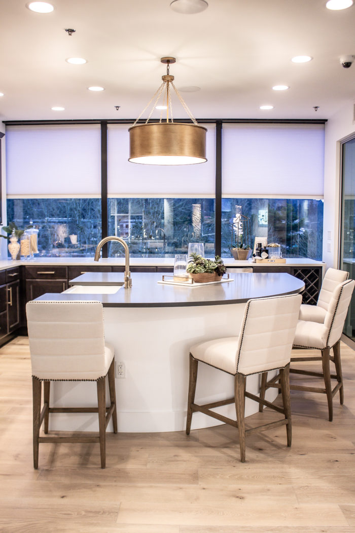 Contemporary kitchen with soft warm tones and gold accents.