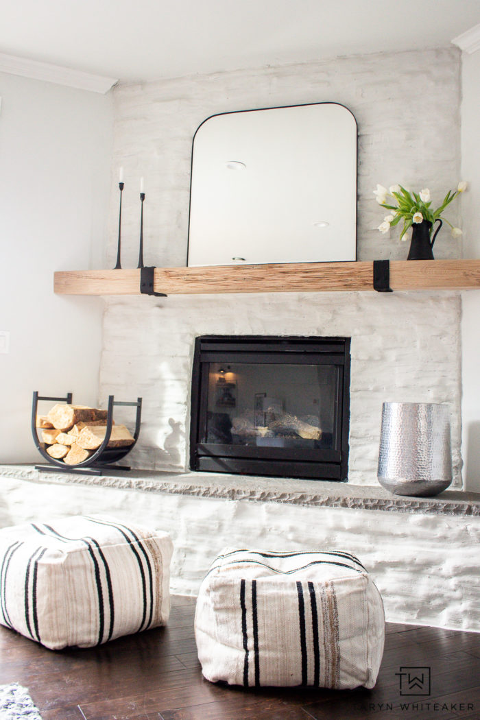 Simple spring mantel decor on a white stone modern fireplace.