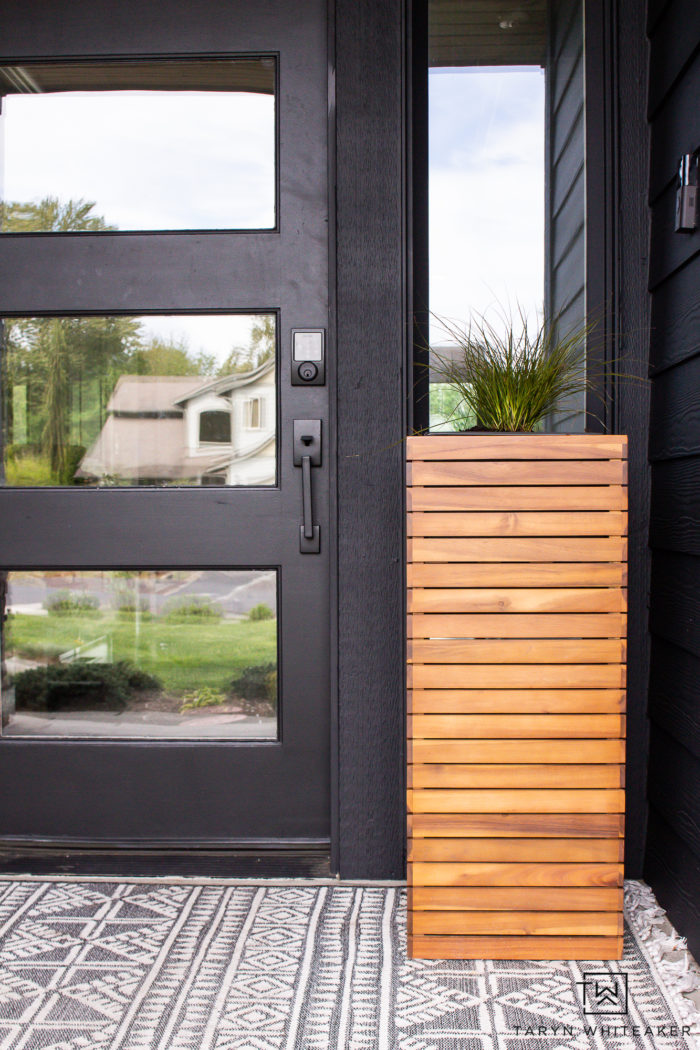 Modern wood planters on spring porch.