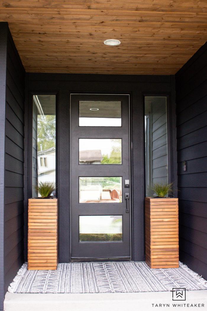 Sherwin Williams Tricorn Black exterior paint on modern spring porch.
