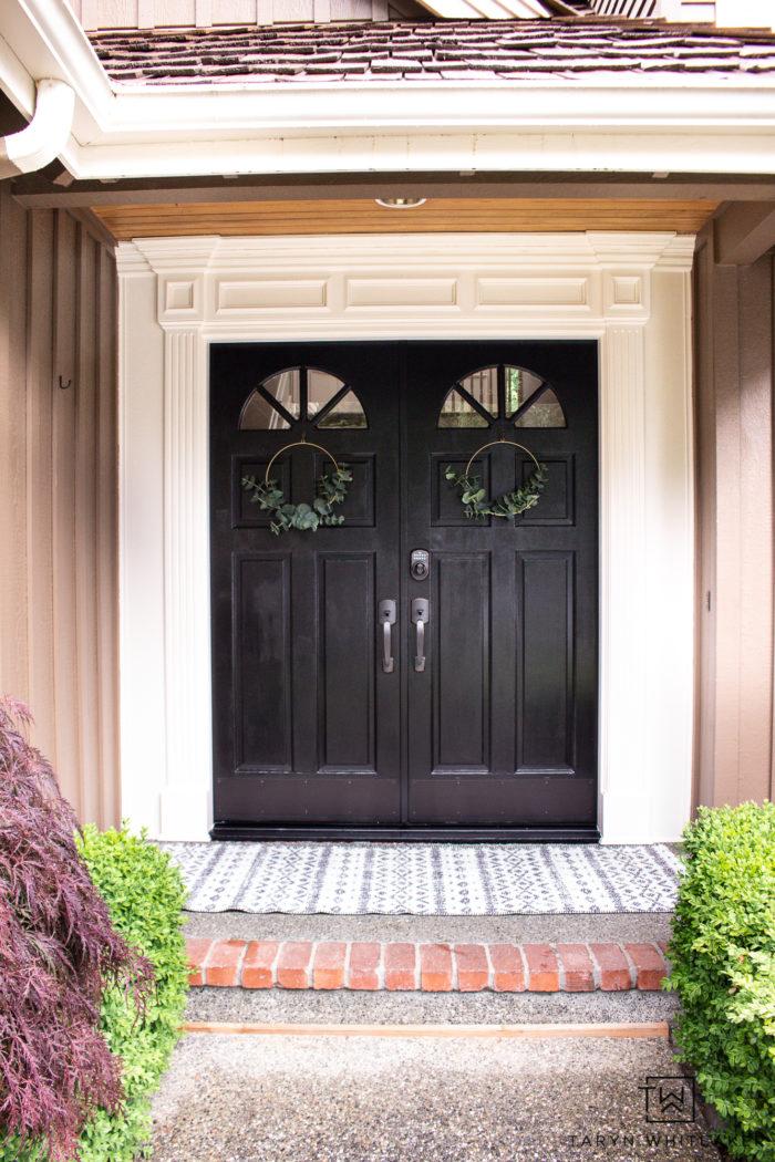 Modern cottage front door with simple front door decor.
