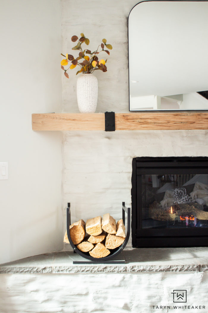 Modern german schmear fire place with raw wood mantel and modern accents.