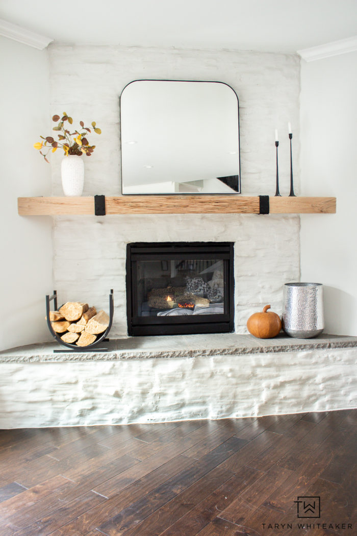 Fall decor does't have to be cluttered. Tour this simple modern fall mantel with warm earth tones and neutral textures.
