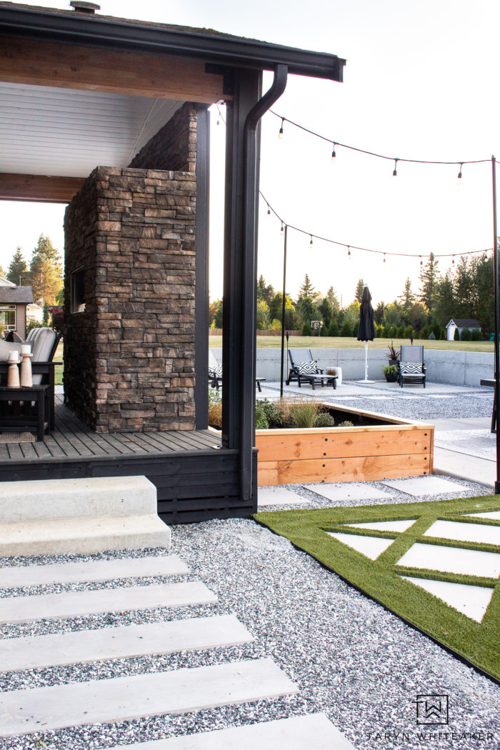 Backyard design with modern concrete wall and turf design.