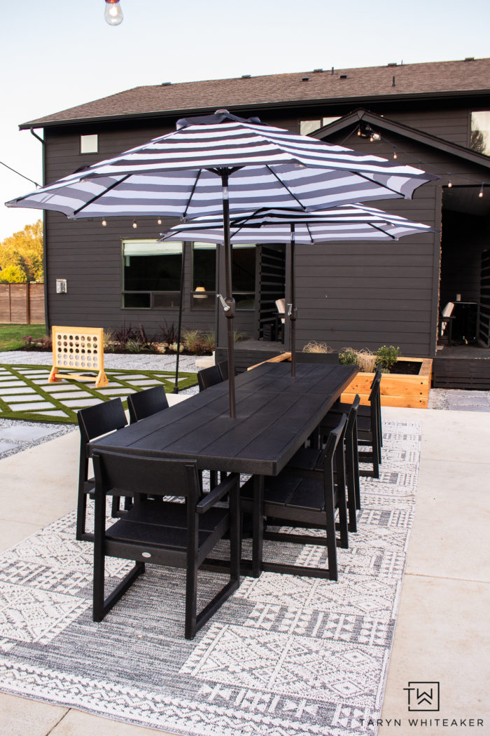 Modern Outdoor black and white Dining Space using two Polywood EDGE Dining Tables to create a large 12 person outdoor dining table.