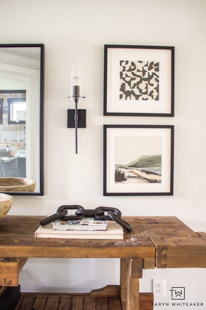 Get these tips for picking out art for an entry way! Tips for blending different artwork together for a cohesive modern look.